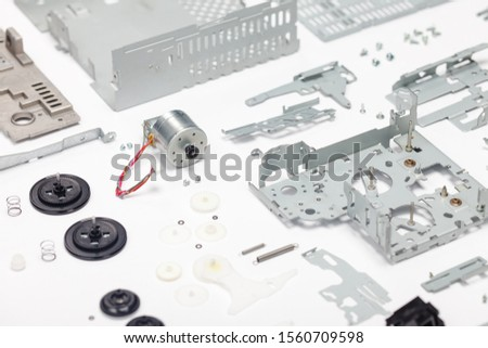 Old obsolete electronics disassembled. Case, knobs, screws, motor, radiator and other parts. Selective focus