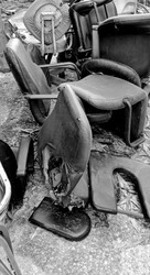 Old office leather chairs abandoned behind a hospital