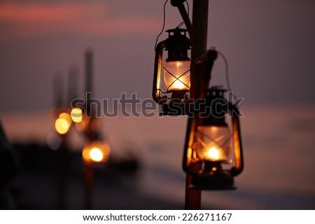 Old oil lanterns on the beach