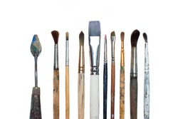 Old oil paint brushes and palette knife isolated
