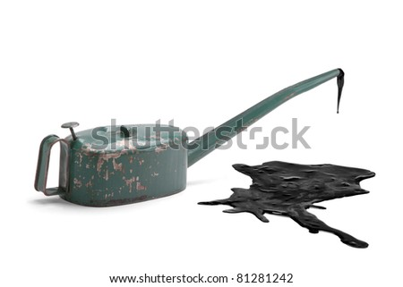 Old oilcan with large oil slick isolated - stock photo