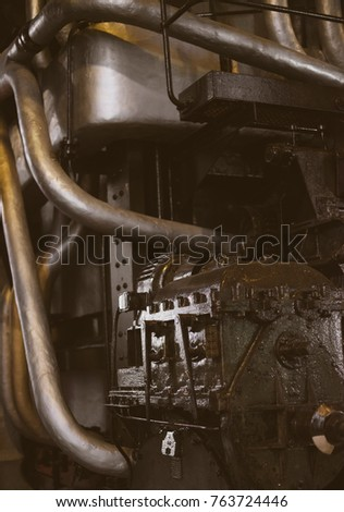 Old oiled engine in the factory. #763724446