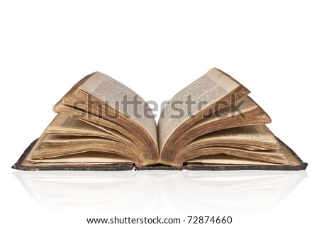 Old open antique bible isolated on white background with clipping path.