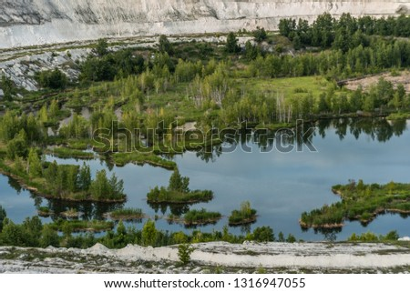 Old open-cast mine.Industrial extraction of chalk and  by mining. Lake in quarry. Abandoned quarry in Volsk.  #1316947055