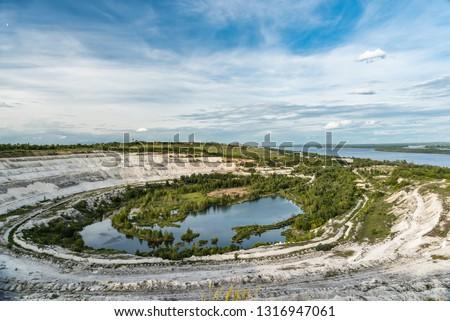 Old open-cast mine.Industrial extraction of chalk and  by mining. Lake in quarry. Abandoned quarry in Volsk.  #1316947061