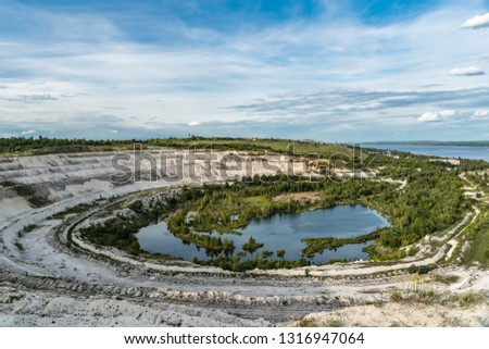 Old open-cast mine.Industrial extraction of chalk and  by mining. Lake in quarry. Abandoned quarry in Volsk.  #1316947064