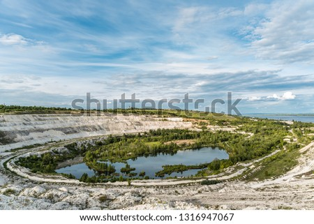 Old open-cast mine.Industrial extraction of chalk and  by mining. Lake in quarry. Abandoned quarry in Volsk.  #1316947067