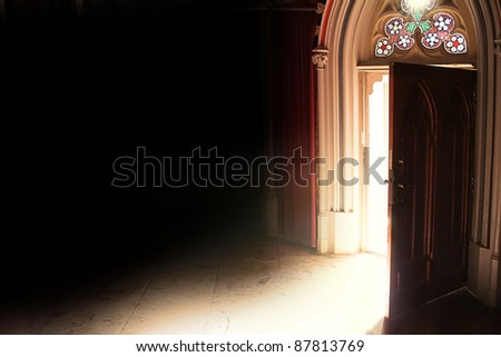 old opened door with light in retro style - stock photo