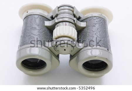 Old opera glasses on a white background - stock photo