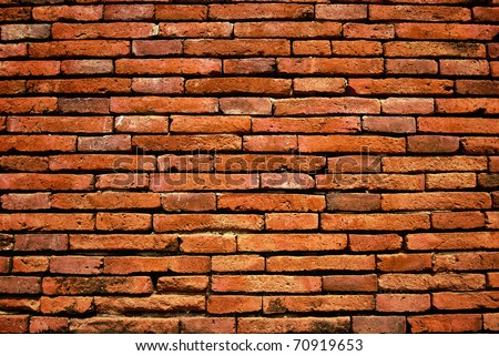 old orange cracked brick wall background texture