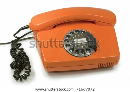 Old orange telephone  isolated on white background
