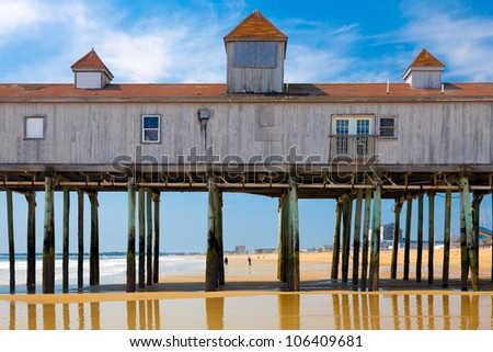 Old Orchard Beach, Maine, historic wooden pier on the sand with reflections