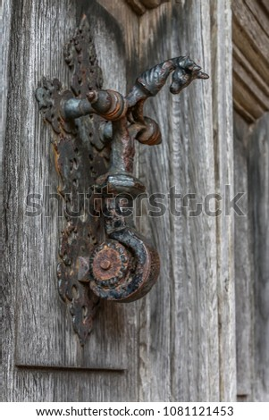 old ornate door knocker #1081121453