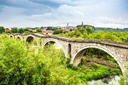 Old ottoman Terzijski Bridge over river Erenik near village Bistrazin in Kosovo