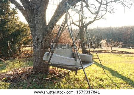 old outdoor old outdoor swing at garden nobody to sit #1579317841