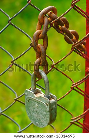 old padlock and rusty  chain in farm