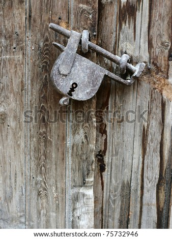 Old padlock on an old wooden door