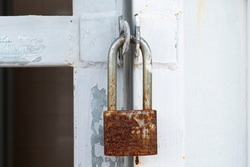 Old Padlock with rust isolated.,Locked Padlock at the metal door.