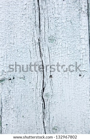 Old paint on a wooden wall/Old wooden planks with cracked light paint