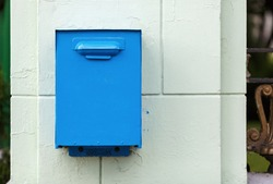 Old, painted in blue mailbox in retro style.