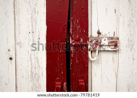Old painted lock on the barn doors.