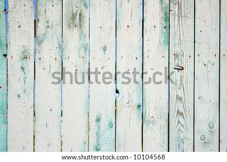 Old painted wooden fence close-up, may be used as background
