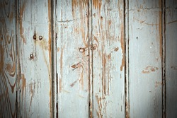 old painted wooden planks with nails and gauge marks
