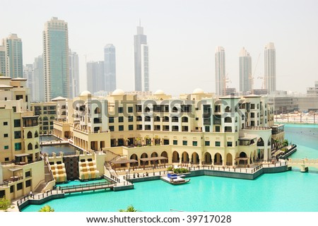 Old Palace hotel in Dubai downtown and artificial lake, United Arab Emirates,