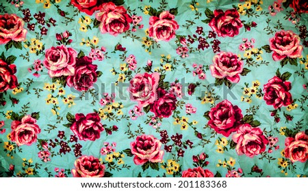 Old paper and rose fabric on grunge background