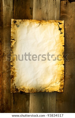 old paper clipped on boards background vertical