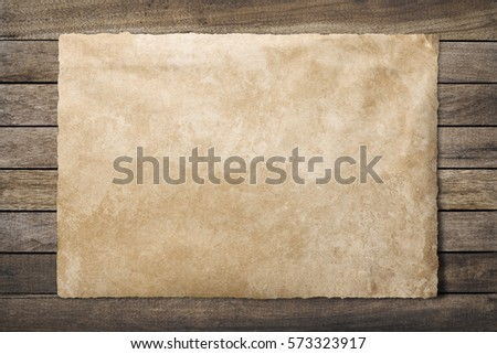 old paper on brown aged wood with clipping path #573323917