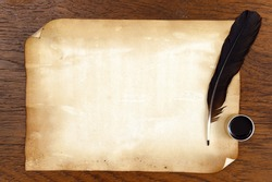 old paper on brown wood texture with feather and ink.