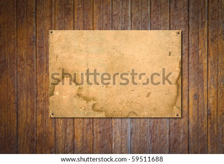 Old paper on brown wood texture with natural patterns - stock photo