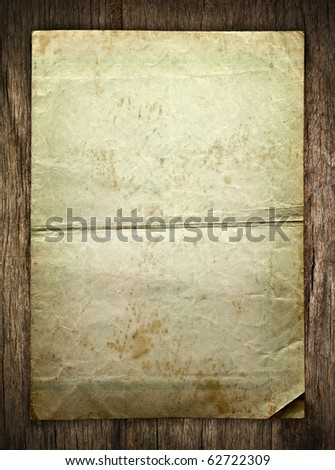 old paper on brown wood texture with natural patterns