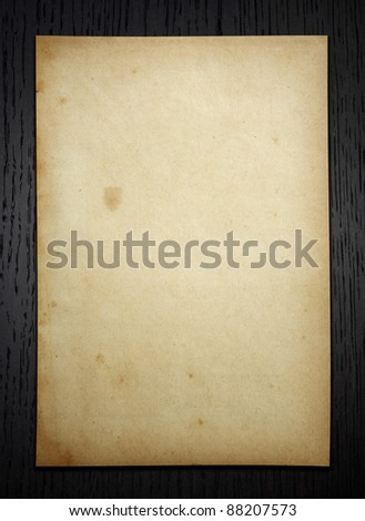 Old paper on dark wood  background with clipping path