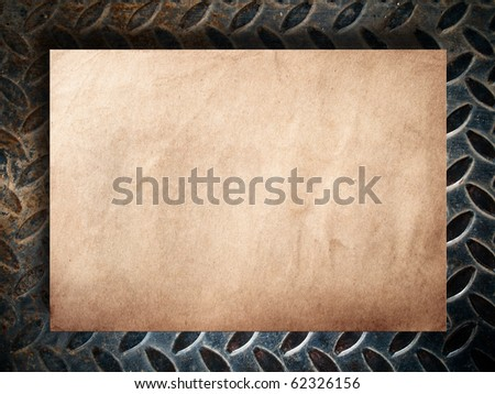 Old paper on grunge metal background