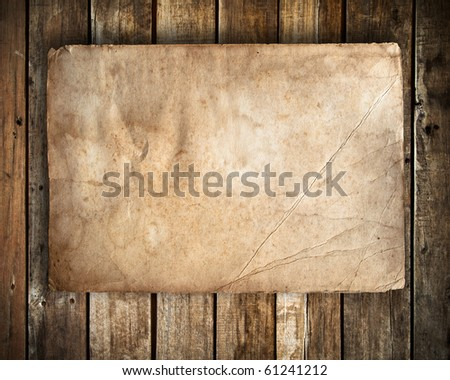 old paper on Grunge wood wall background