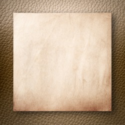 Old Paper On Light Brown Leatherette Background