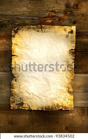 old paper on wooden board background vertical