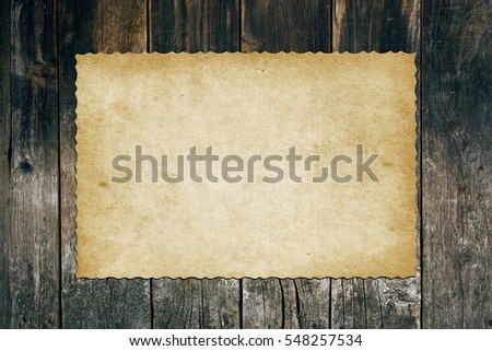 Old paper on wooden board. Retro style #548257534