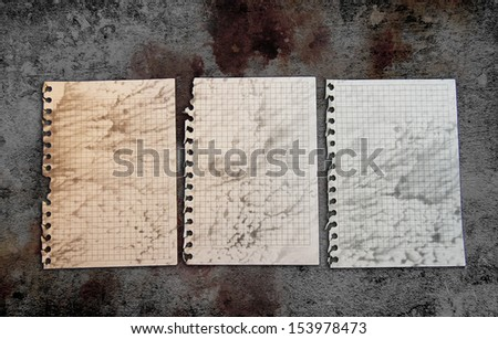 Old paper pages on a grunge background