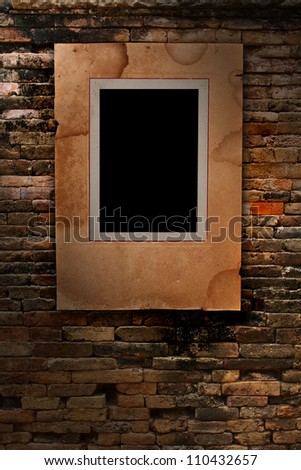 old paper photo frame on old brick wall texture, grunge industrial interior Uneven diffuse lighting version (Save Paths For design work)