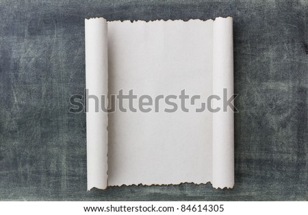 Old paper scroll on a black broad background