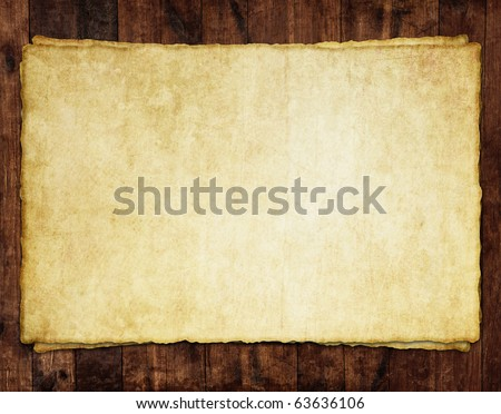Old paper sheet on wooden background