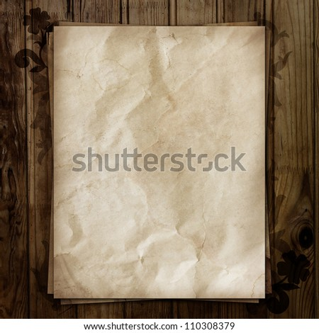 Old paper sheets on wooden background