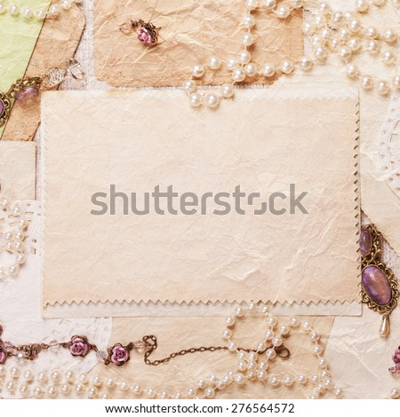 old paper sheets surrounded by retro women\'s accessories