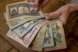 Old paper tsarist money of the Russian Empire in the hands of a woman