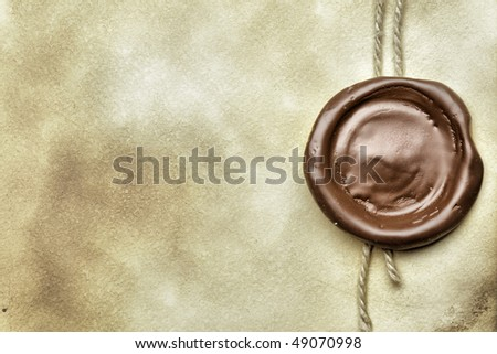 Old paper with wax seal close up - stock photo