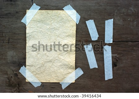 Old paperon grunge wood background.