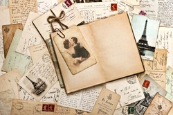 old papers, french post cards and open diary book. romantic vintage background